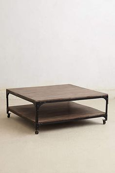 Large Decker Coffee Table - anthropologie.com   I know you you want something cozy.  But, saw this and thought it was pretty awesome.