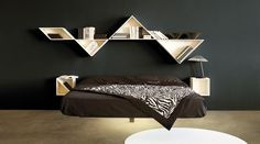 Lago Tangram shelf  A patented product for rooms with a design edge. A bookcase with infinite combinations.  The concept for Tangram Storage draws on an ancient Chinese game involving a square divided into seven parts. The resulting shapes include a square, a rhomboid and five isosceles triangles (two large, one medium and two small).  http://www.industryinterior.com/en/prod/living-room/library/lago-tangram-shelf.html