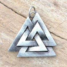 Viking knotted talisman - Valknut. Size: 2.5 x 2.8 cm.    Well known viking symbol from runic stones (for example: Tängelgårda stone on the