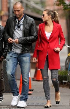 Retired life looks good on him: Derek Jeter appears content as he strolls with girlfriend Hannah Davis in New York City.