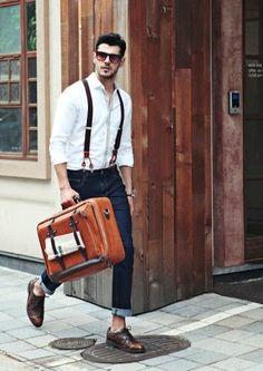 Shop this look on Lookastic:  https://lookastic.com/men/looks/long-sleeve-shirt-skinny-jeans-brogues-sunglasses-suspenders/11264  — Dark Brown Sunglasses  — White Long Sleeve Shirt  — Dark Brown Suspenders  — Navy Skinny Jeans  — Dark Brown Leather Brogues