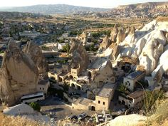 "Golden lunarscapes are the backdrop of this simple Turkish town that's still growing out of its traditional farming customs. Göreme is famous for its curious ""fairy chimney"" rock formations, some of which were hollowed out to create houses and churches."