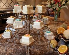 Lemon and Orange Glazed Petits Fours  Print Prep time 0 min Cook time 0 min Total time 0 min  Serves: Makes 16 petits fours Ingredients Buttercream frosting: 8 tablespoons butter, softened ½ teaspoon vanilla extract 3 cups powdered sugar 2- 4 tablespoons milk dash salt food coloring For Glaze: 2 …