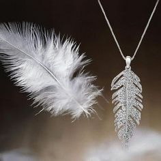 Whether it's a big date or the big day, this rhinestone feather pendant will have you dancing on air.
