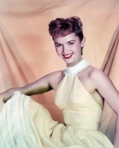 lifes-commotion:    Debbie Reynolds in a yellow dress.