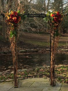 Decorated arch for an outdoor fall wedding |The Pod Shop Flowers on flickr. #weddingarch #fall