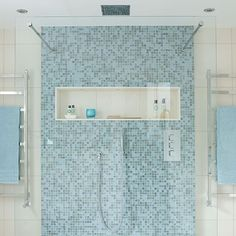 Minimalist shower with walk-in shower and blue mosiac tiles