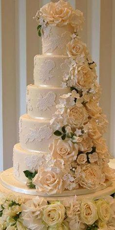 A gorgeous cascading flowers wedding cake. Pretty Wedding Cakes, Unique Wedding Cakes, Wedding Cakes With Flowers, Beautiful Wedding Cakes, Wedding Cake Designs, Pretty Cakes, Beautiful Cakes, Amazing Cakes, Cake Flowers
