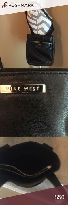 Nine West brand. Black. Leather. Shoulder. Bag. This. Has. A. Middle. Compartment. That. Zips. It. Has. A.  Out. Side. Zipper. Pocket   It. Has. Long. Shoulder.  Strap. For. Carry    All. Leather   Nine. West. ((((New))) Nine West Bags Shoulder Bags