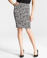 "Petite Leopard Print Skirt - Fierce fashion: our pounce-worthy leopard print skirt redefines day to night dressing with a sleek, contoured fit. Exposed metal back zipper with snap closure. Back vent. Lined. 21"" long."