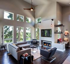 Natural Eclectic Living Room Interior Design With Modern Fireplace Insert On The Wall Under The Tv As Well Wooden Floor And Hanging Fan And Lighting Complited Top Eclectic Living Room Interior for Your House Decoration Interior design
