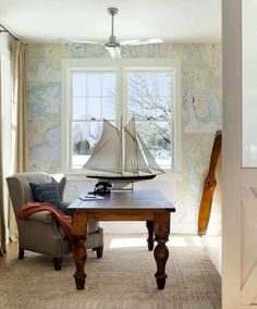 Elegant beach style home office with interesting wallpaper