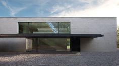 Uccle _Belgium | Marc Corbiau - Bureau d'Architecture. Concrete. Black. Large windows.