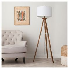 Standing tall and strong on 3 slender legs, the Threshold Oak Wood Tripod Floor Lamp brings incandescent style to your living room or bedroom. The base built from tapered wooden posts is fitted with metal hardware for a graceful, modern furniture look all capped off with a simple white shade. This look pairs with a wide variety of furniture styles for a versatile lighting option you'll love.