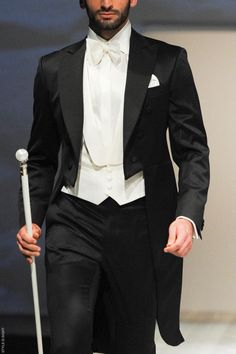 Archetipo Cleofe bridal spring/summer 2014: inspired by the high collars with a bow tie, tuxedo jacket with tails, and a cane