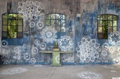 Street art by NeSpoon // She uses traditional lace patterns and forms to create something new and unexpected in urban ares