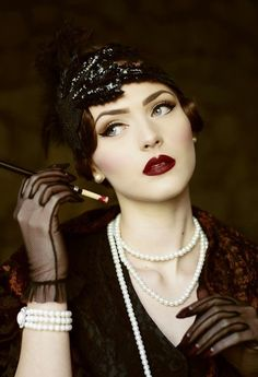 Dark 1920's Flapper Look by Nina and Muna --- 1920's makeup inspiration - Sharp cupids bow & Matte Base Red lipstick got their colour from cochineal insects. Their lips were filled in smaller than the natural outline except for the cupids bows which was exxagurated.