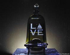 """You are looking at slumped (melted) bottle cheese board wall hanging with a """"Spread the Love"""" labelled spreader knife. The bottle has """"LOVE"""" etched on it, with a sailboat as the """"O"""". These pieces are Wine And Liquor, Liquor Bottles, Glass Bottles, Wine Glass, Slumped Glass, Fused Glass, Bottle Slumping, Wine Bottle Art, Gifts For Wife"""