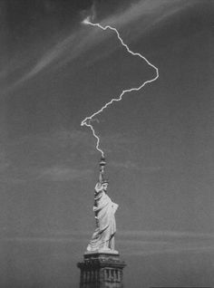 "Lightning hits the Satue of Liberty during a storm, NYC ""WOW"""