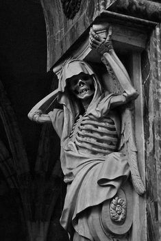 """One of two """"Guards"""" at the church tomb of a minister of Louis XIII. At Châteauneuf-sur-Loire, France."""