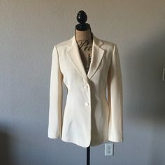 Ann Taylor 100% Silk Blazer This beautiful blazer is so chic. It does have two small spots which would probably come out with dry cleaning. Otherwise it's in excellent condition. It has been priced accordingly. Ann Taylor Jackets & Coats Blazers