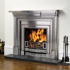 Looking for a fire surround for your living room? A fireplace and smart fire surround are great ways to bring a room together. We've selected our pick of the best fire surrounds. Metal Fireplace, Stone Mantel, Paint Fireplace, Victorian Fireplace, Stove Fireplace, Electric Fireplace, Fireplace Surrounds, Fireplace Ideas, Classic Fireplace