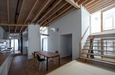 KW House is a minimalist house located in Anjo, Japan, designed by WORKCUBE. The two-story wooden residence is tucked between a commercial and residential lot. (2)