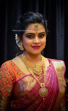 Simple, elegant and gorgeous. Chandini for her varapooje function. Makeup and hairstyle by Swank Studio. Coral lips. Bridal hairstyle. Hair bun. South Indian bride. Eye makeup. Bridal jewelry. Bridal hair. Silk sari. Bridal Saree Blouse Design. Indian Bridal Makeup. Indian Bride. Gold Jewellery. Statement Blouse. Tamil bride. Telugu bride. Kannada bride. Hindu bride. Malayalee bride. Find us at https://www.facebook.com/SwankStudioBangalore