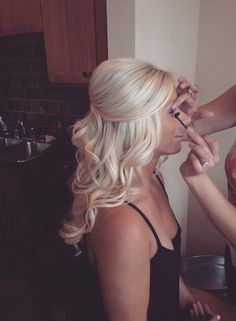 curly platinum blonde hairstyle, front pulled back