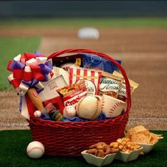 Sports gift basket ideas for men. ball, ceramic desk top bank, baseball mug, baseball frame, chocolate chip cookies, tortilla chips, nacho cheese dip, summer sausage, cracker jacks, beer nuts, white cheddar popcorn and a Double Bubble bat filled with bubble gum!
