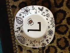 Sharpie on a ceramic plate! Bake for 30 mins at 355 degrees and it becomes permanant!