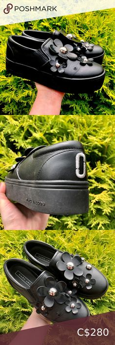 """MJ Black Leather Platform DAISY SLIP-ON SNEAKERS MARC JACOBS Black LEATHER & RUBBER SLIP-ON FLOWER DETAIL PLATFORM SHOES: """"DAISY SLIP-ON SNEAKERS"""" 🖤 🦋 Sold out ONLINE 🦋 • Women's Size EUR 36, US 6, UK 3.5 • A bit dusty from being in storage but will come cleaned and packaged with care 100% Leather Outer one missing piece shown in pic 2, but not noticeable when wearing. Other wise in excellent hardly worn condition! Platform is Approx. 1.5"""" high 🖤 ORIGINALLY BOUGHT FOR: $290 USD + tax… Marc Jacobs Sneakers, Marc Jacobs Shoes, Black Sneakers, Slip On Sneakers, High Top Sneakers, Black Suede, Black Leather, Mens Stainless Steel Rings, Marc Jacobs Daisy"""