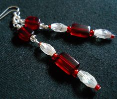 These simply beautiful earrings are all handmade with Silver and Red Czech Glass E-Beads, and Red and White Acrylic Beads! Connected by fish/french hook wire