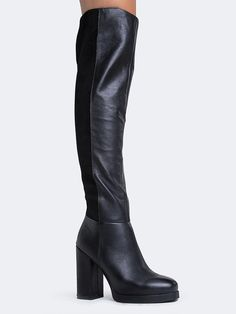 - These sexy, over the knee boots are just what you need to take your look to the next level. - Thigh high boots have a square toe and a two tone panel design with leather and suede. - Non-skid sole a