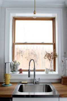 I really like how this farmhouse sink covers the whole counter front to back.  I also like the wooden counters.  I'm just worried about the upkeep of said counters.  I wish I had a window and a view in my kitchen.  Instead I have barren walls.