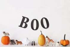 """Halloween Decor // Masked Animals: """"I cut my masks out of black paper and taped 'em on. The zebra ghost is made from scrap white fabric That I cut holes in. (The BOO banner aussi just made from paper)."""" ohmahgoodness adorable."""