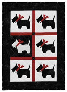 "Scotty/Westie appliqué crib quilt:   ""There's one in every crowd"" by Kay Mackenzie.  In the book 'Easy Appliqué Blocks: 50 Designs in 5 Sizes'"