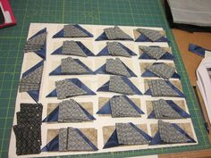 """Allietare Mystery Quilt step 2 Link-up party.  All cut out and waiting to sew the """"santa hats"""".  Blue replacing red."""