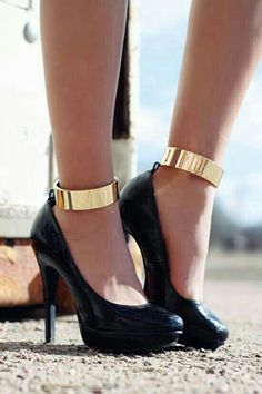 Black heels/gold ankle cuffs.