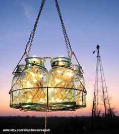 use a canning jar lifter rack! - Antique Lights Mason Jar Chandelier 6 Blue QUART by treasureagain, $125.50