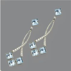 PAIR OF AQUAMARINE AND DIAMOND PENDANT-EARRINGS. The pendants anchored by square-cut aquamarines set in chevron motifs, suspended from narrow interlaced fringes and square-cut aquamarine surmounts, mounted in platinum. Gems Jewelry, Jewelry Box, Jewelery, Fine Jewelry, Pendant Earrings, Stud Earrings, Antique Jewelry, Vintage Jewelry, Aquamarine Jewelry