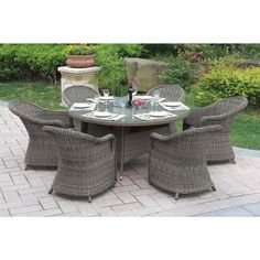 $1,619.99   Table Dimensions: 60 inches diameter x 29 inches high  Chair Dimensions: 25 inches long x 29 inches wide x 33 inches high   Bolinas Serenity Dark Brown/ Tan 7-piece Patio Set