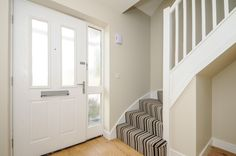 The Elmswood @ Woodlands, Launton. Striped Moods carpet carpet used on the curved staircase. The woven product is excellent for high traffic areas. Engineered oak flooring throughout the rest of the ground floor. Walls are painted in Dulux Egyptian Cotton and Satinwood for the woodwork.