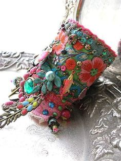 Monsoon, Gypsy Jangle, Bracelet, Bohemian Gypsy, Cuff, Vintage, Embroidery, Boho Jewelry This is my latest Gypsy Jangle bracelet that is the most intricate and bead encrusted design right now... Ill begin with the lovely vintage flower hand embroidery that runs around the top #vintageembroidery #embroiderybracelets