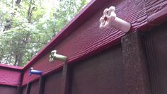"Old faucet handles, pieces of PVC piping, 4"" decking screws and some spray paint: instant water-themed towel hangers for an outdoor shower or pool area!"
