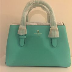 HPKate Spade Cove Street  Provence Purse Brand new never used Kate Spade Purse from the cove street collection in fresh air. It comes with the shoulder strap. It is made from saffiano leather. Perfect for spring time! The height is 8.2 the bottom length is 12.5, top length  is 10.5 and depth is 4.5. Bundle with the wallet today to save ! kate spade Bags
