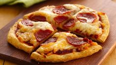 Mini Pizzas - 1 can (16.3 oz) Pillsbury® Grands!® biscuits  1 c pizza sauce  2 c shredded mozz cheese (8 oz)  1 pkg (3.5 oz) sliced pepperoni. Press each biscuit into 6-in round. Place on 2 large or 3 small greased cookie sheets. Top each round with pizza sauce, cheese & pepperoni. Bake at 375°F 10 to 15 min or until bottoms are deep golden brown & cheese is bubbly.