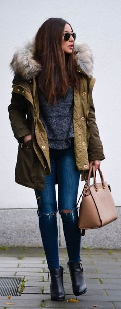 Olive green jacket with faux fur hood + charcoal sweater + skinny jeans + black boots + brown handbag