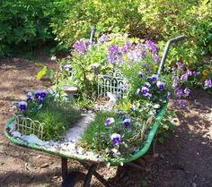 Wheelbarrow turned flower garden