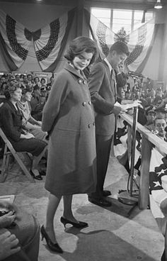 Jackie Kennedy on stage with her husband John Kennedy on November